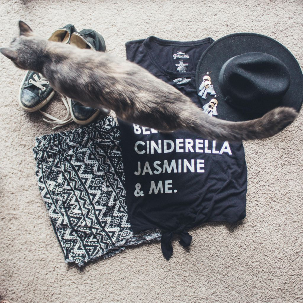 Image shows a outfit laid out with Bunty the cat walking across the clothing.